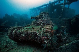 Japanese ship San-Francisco-Maru and tank encrusted with marine life in the lagoon at Truk Atoll, Micronesia, South Pacific, make up a tiny fraction of the undersea debris of  WWII.   Internet photo